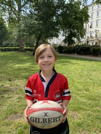 Year 2 pupil and his rugby team raise £50k
