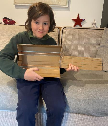 In Music: Homemade Musical Instruments, Writing Music and Learning about Blues